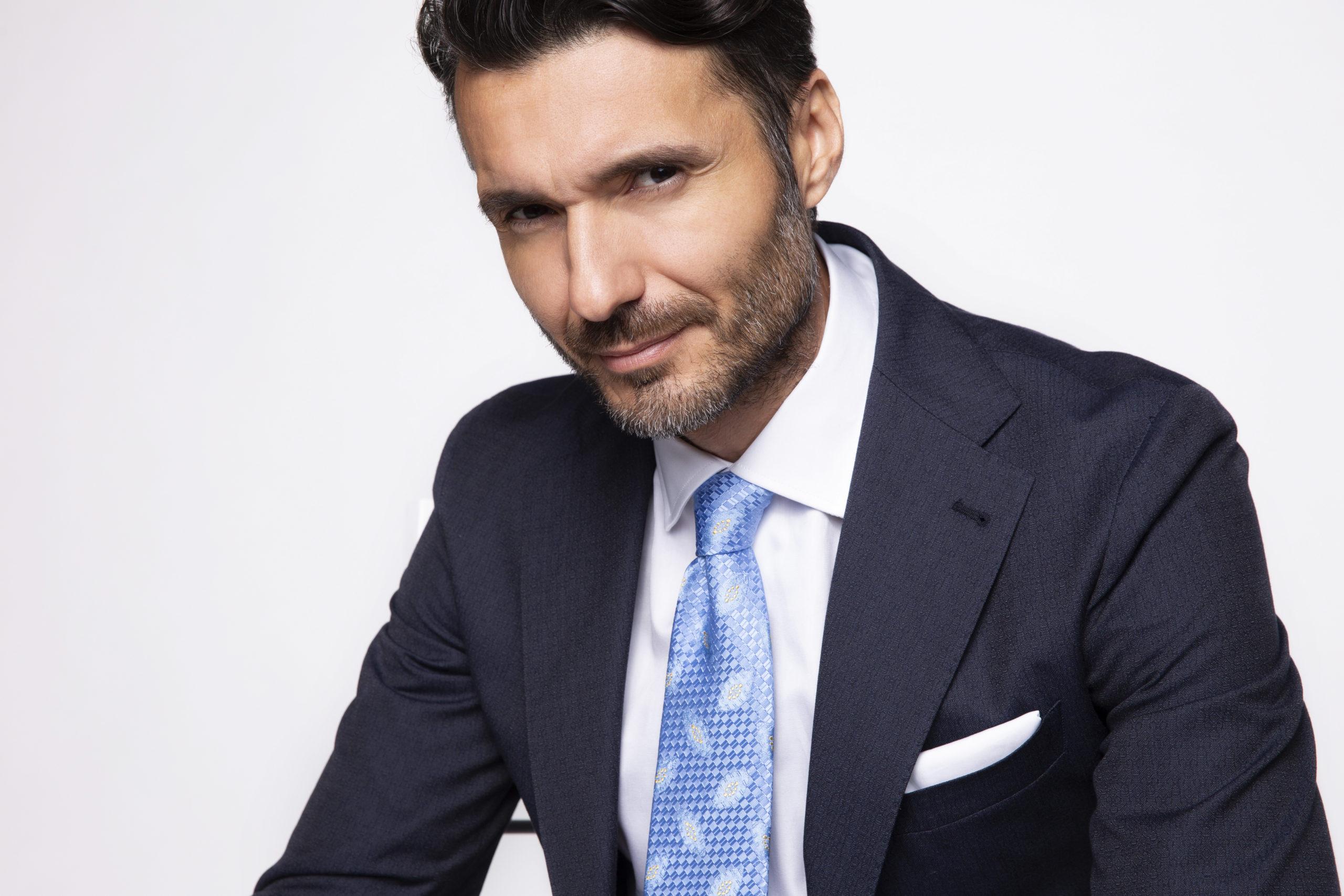 Model wearing SS20 light blue woven silk tie by Italo Ferretti